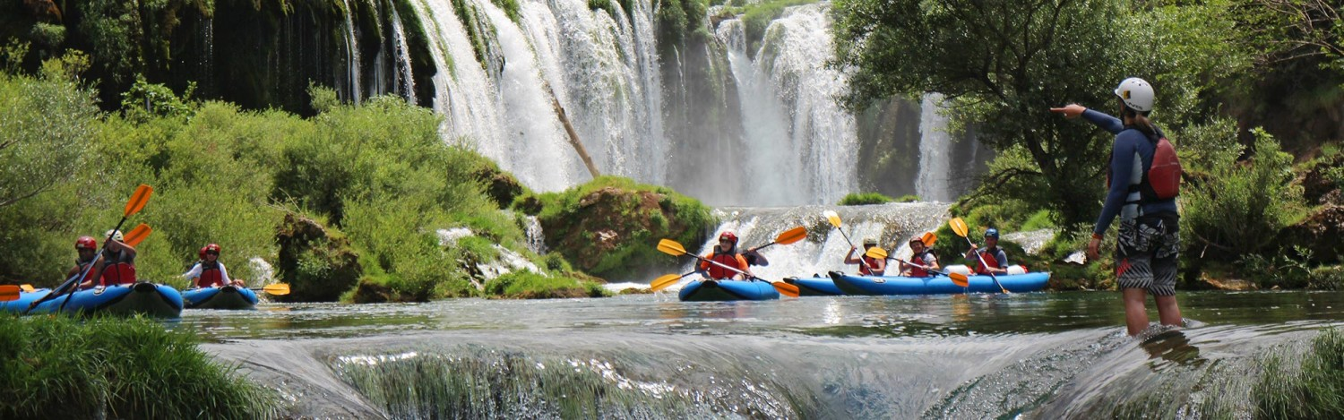 people-paddling-below-high-waterfall-on-zrmanja-river-1