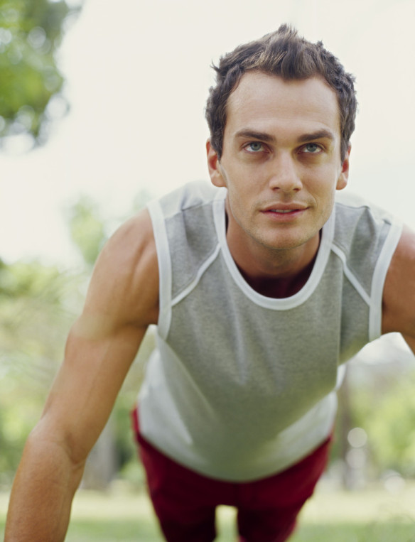 young man exercising in a park --- Image by © Royalty-Free/Corbis