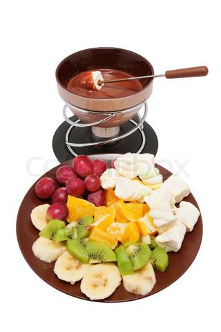 6429517-170039-chokolade-fondue-og-skaaret-frugt-paa-en-tallerken