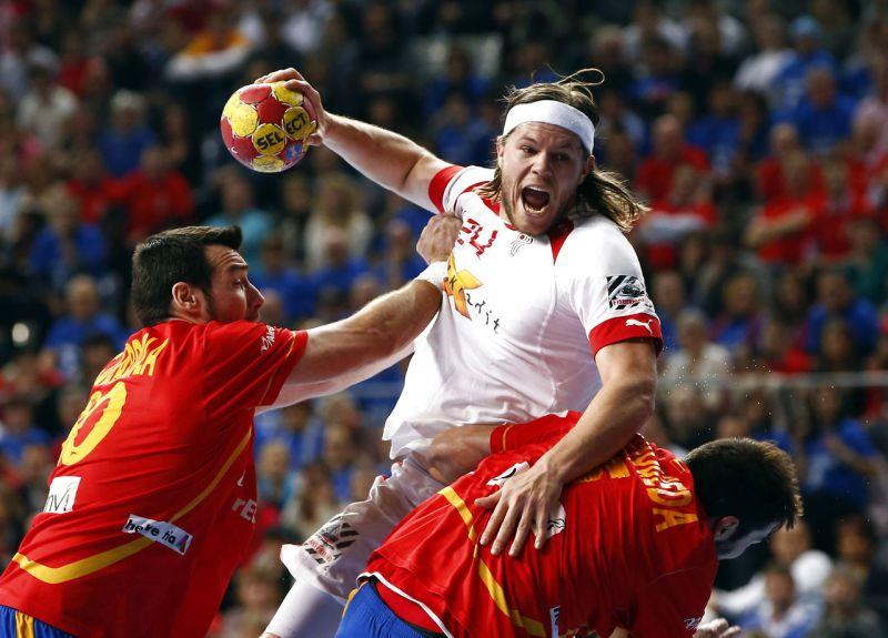 Denmark's Hansen is challenged by Spain's Guardiola during their Men's Handball World Championship final match in Barcelona