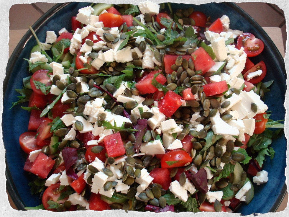 Salad with watermelon, feta cheese and pumpkin seeds