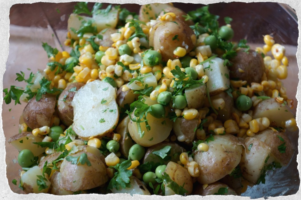Summer salad with potato, corn and peas