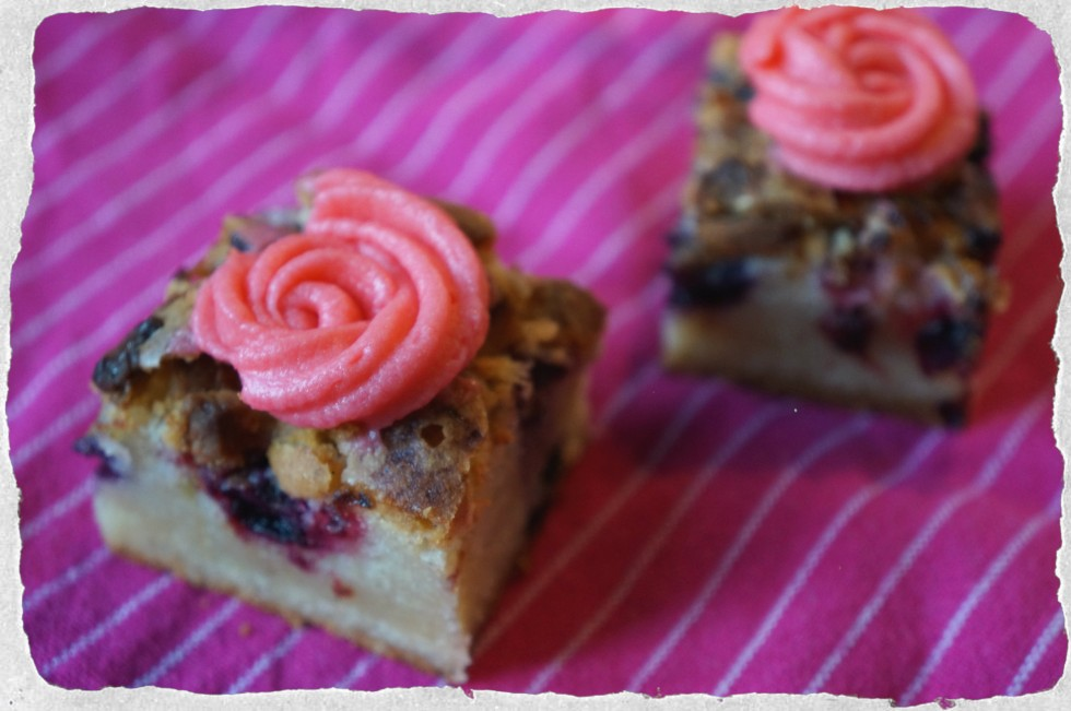 Blondies with berries and raspberry frosting
