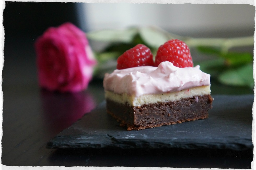 homemade brownie cheesecake with raspberry topping