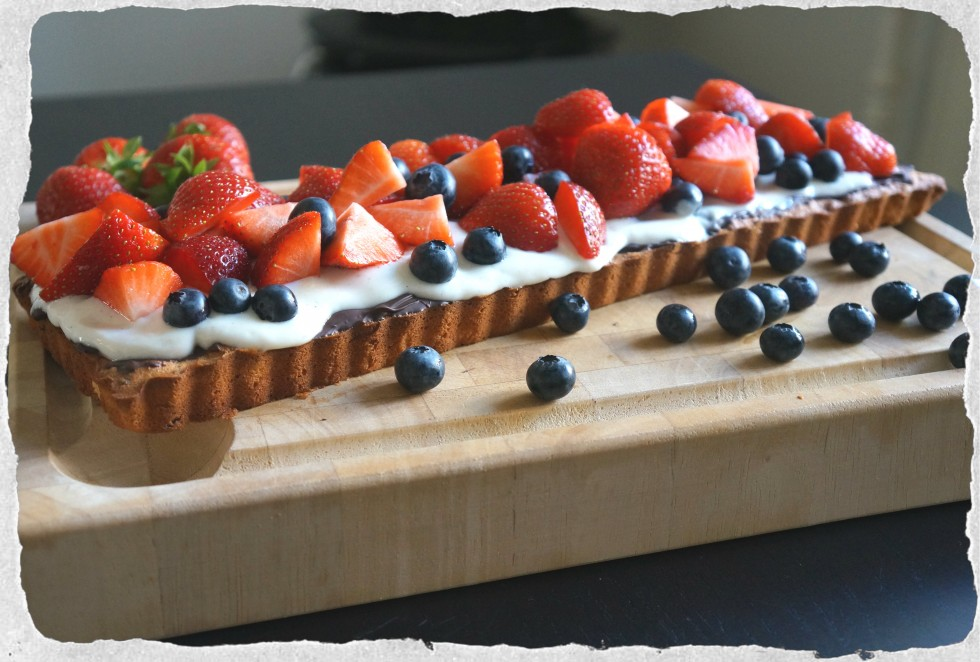 Homemade marzipan tart with berries