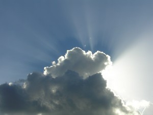 Sol og skyer