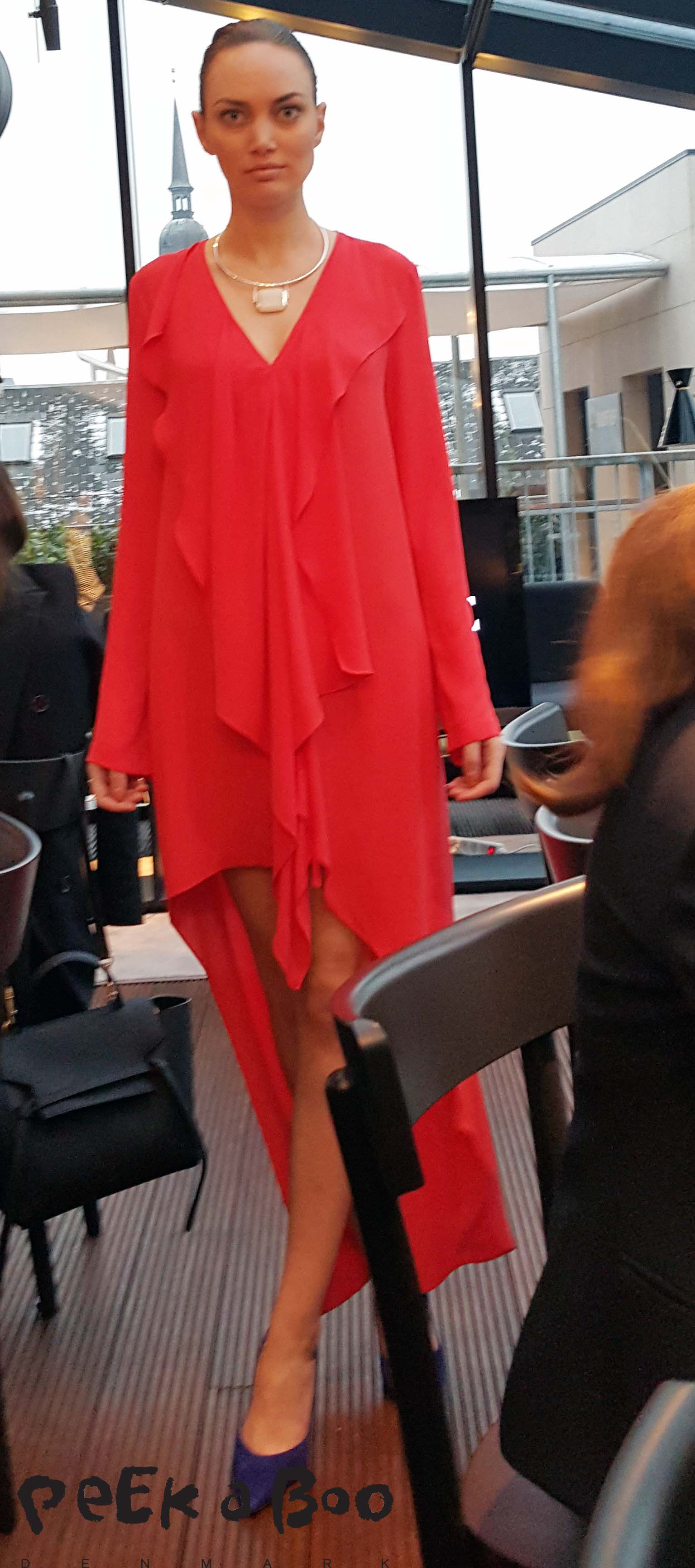Orange party dress from BCBG Maxazria SS16 collection. They will open a shop in Copenhagen later this month.