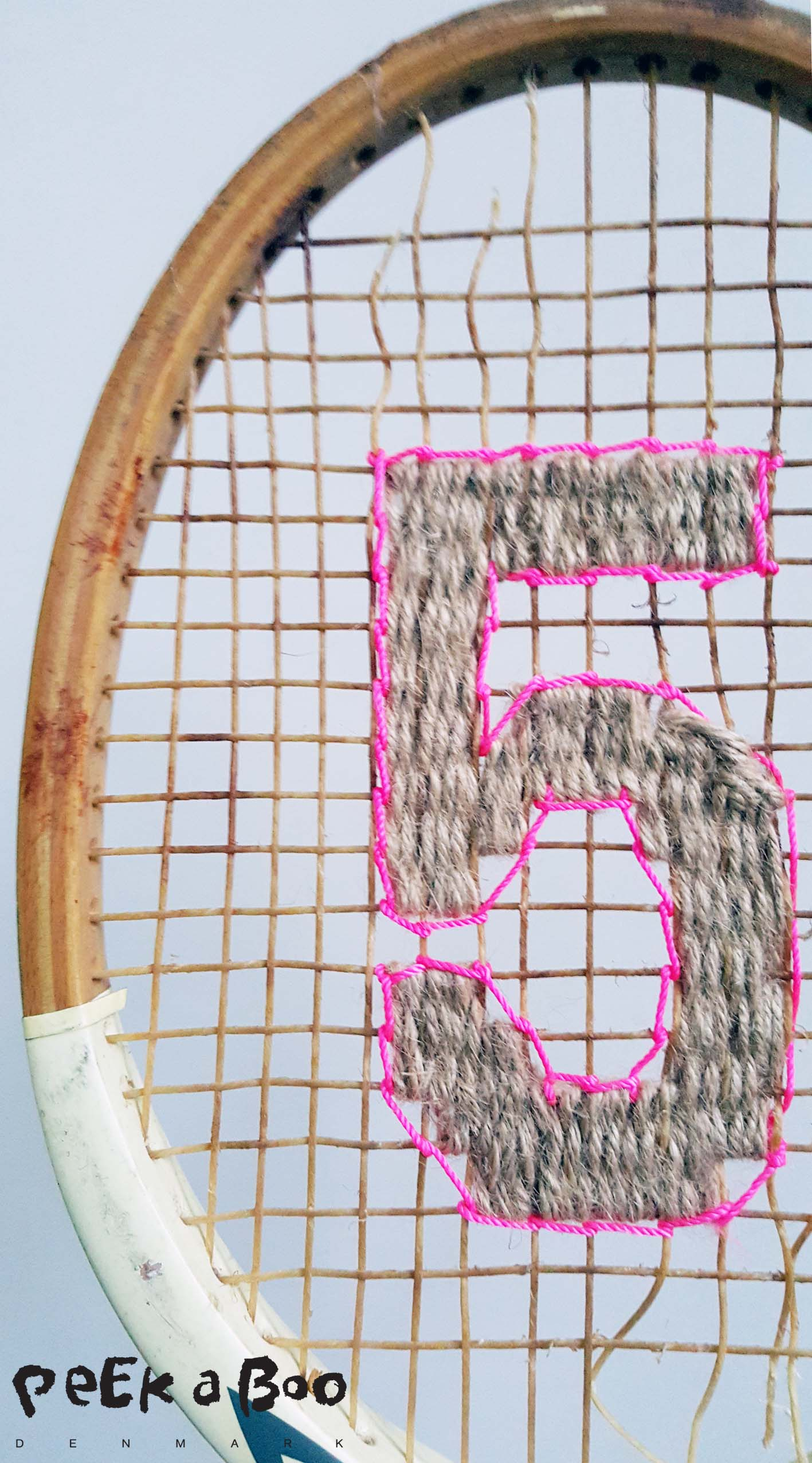 DIY vintage tennis racket for your home decor. Made by Peekaboo design.