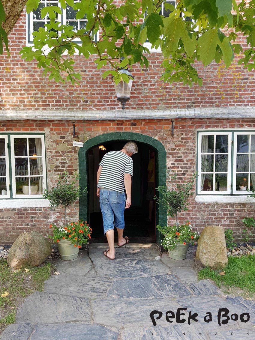 The main entrance of the inn, with the low door.
