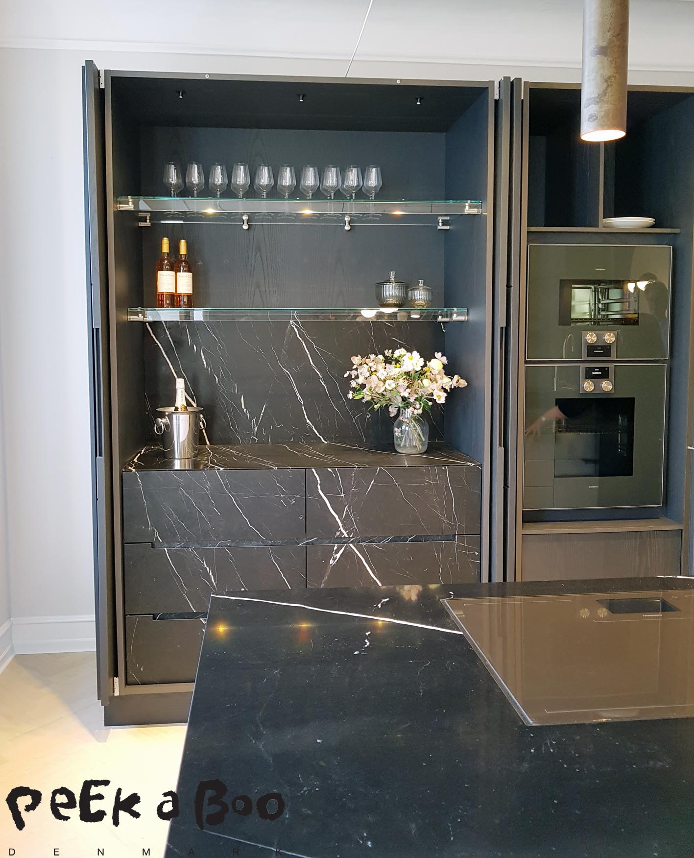 And when you open the doors....you get this...a black marble bar.