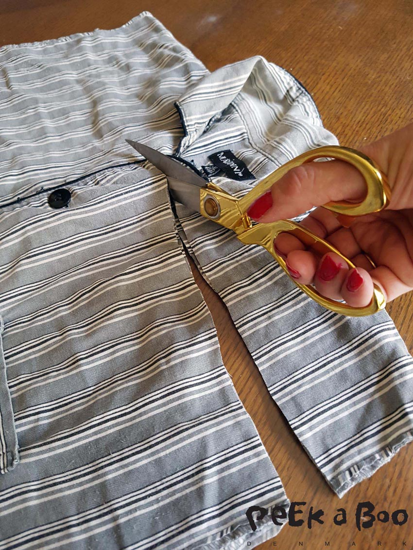 Then you cut off the upper part of the shirt. to mid of the sleeve opening.