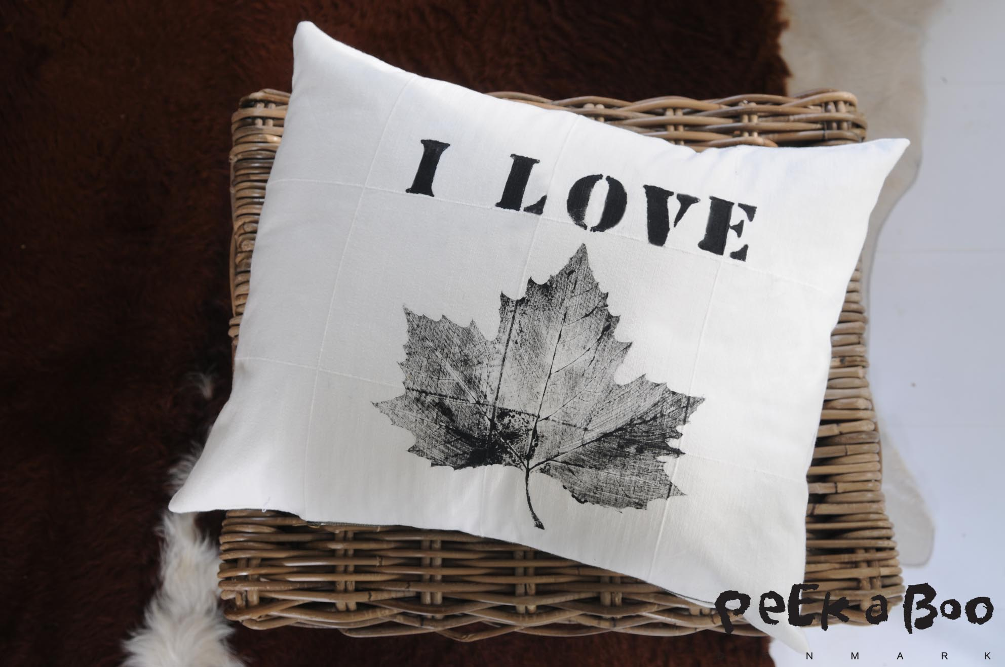 Pillowcase printed with leaf and stencil letters.