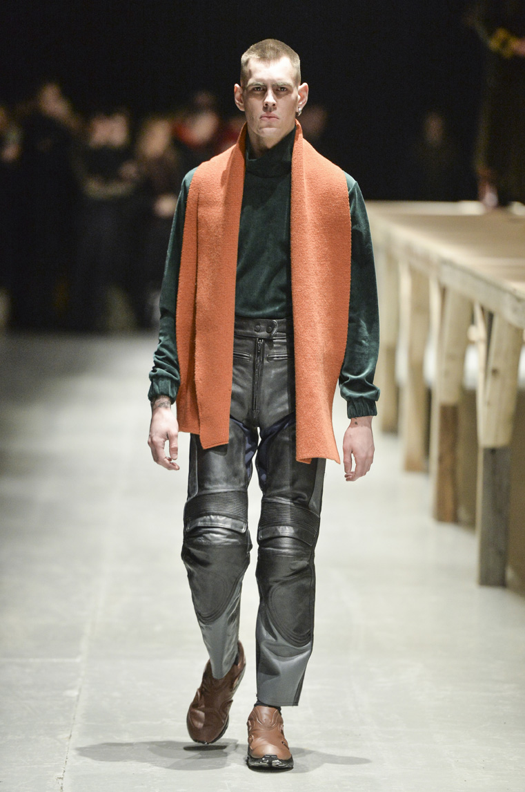 Leather pant with functional details, and orange scarf to brighten up the look.