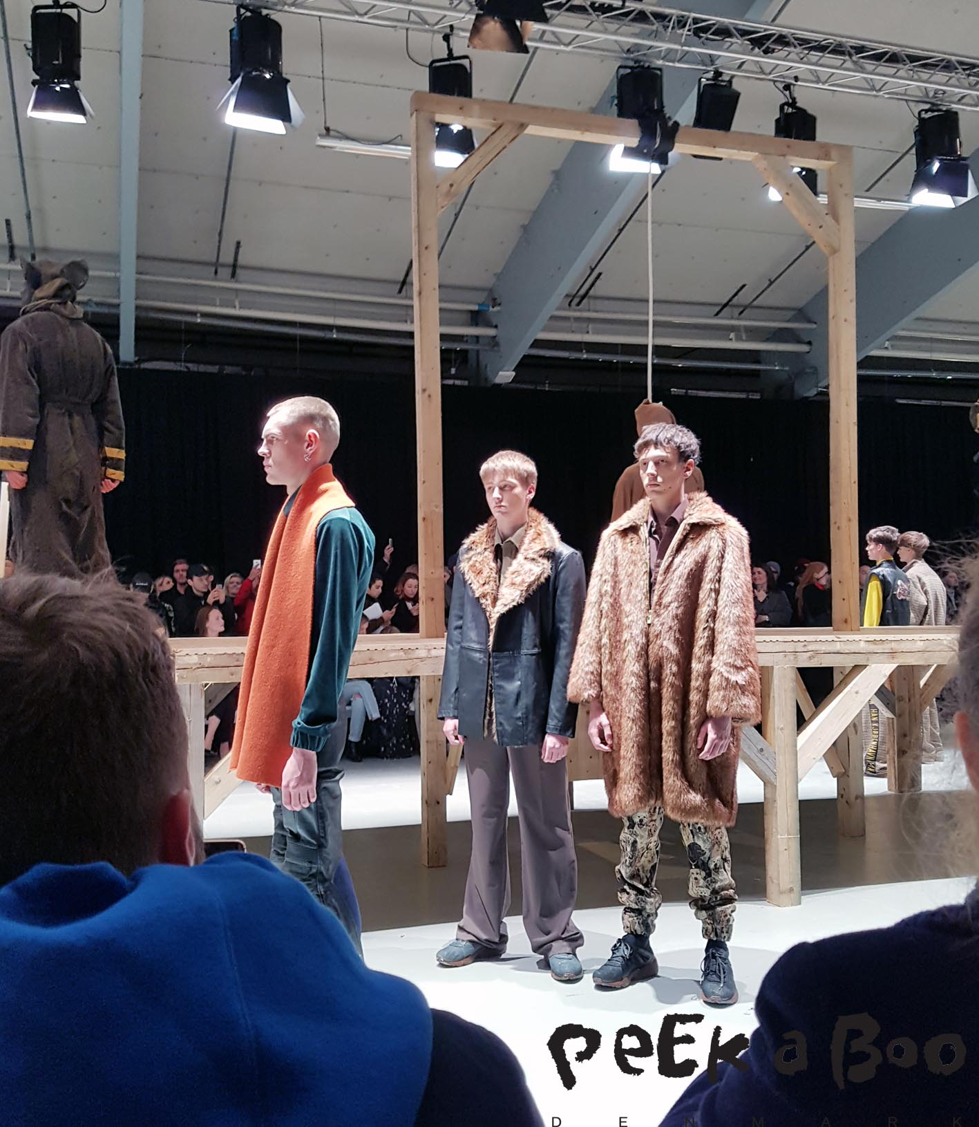 Three models after the show. Cool fur coat, and fur trim on one of the jackets, and a really cool colourpalette.
