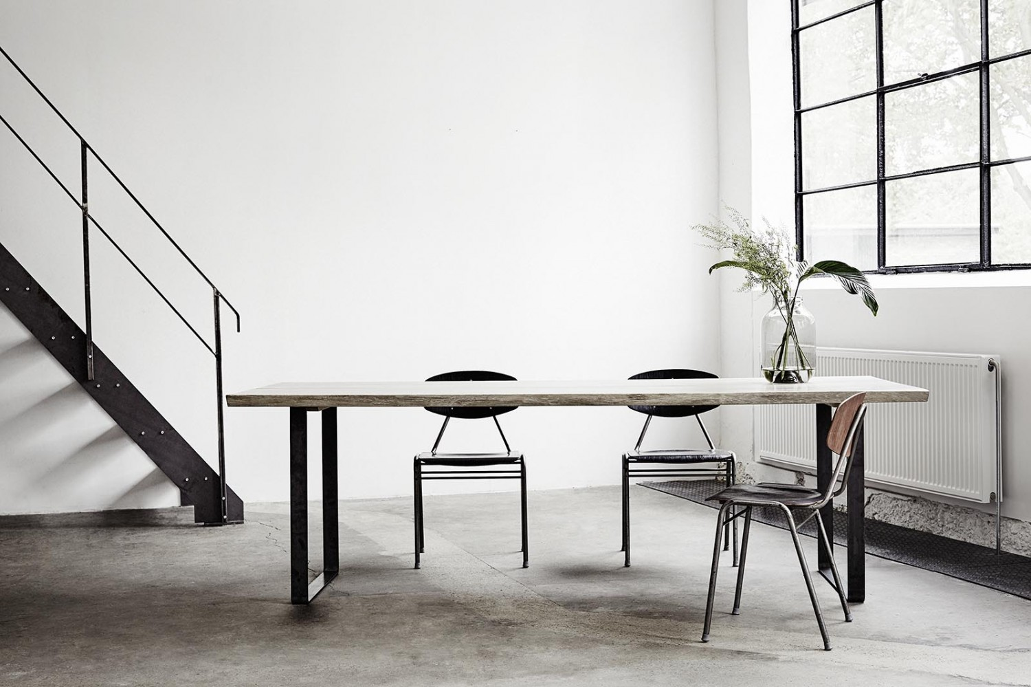 ent Copenhagen plank table made of oak tree and their metal table legs.