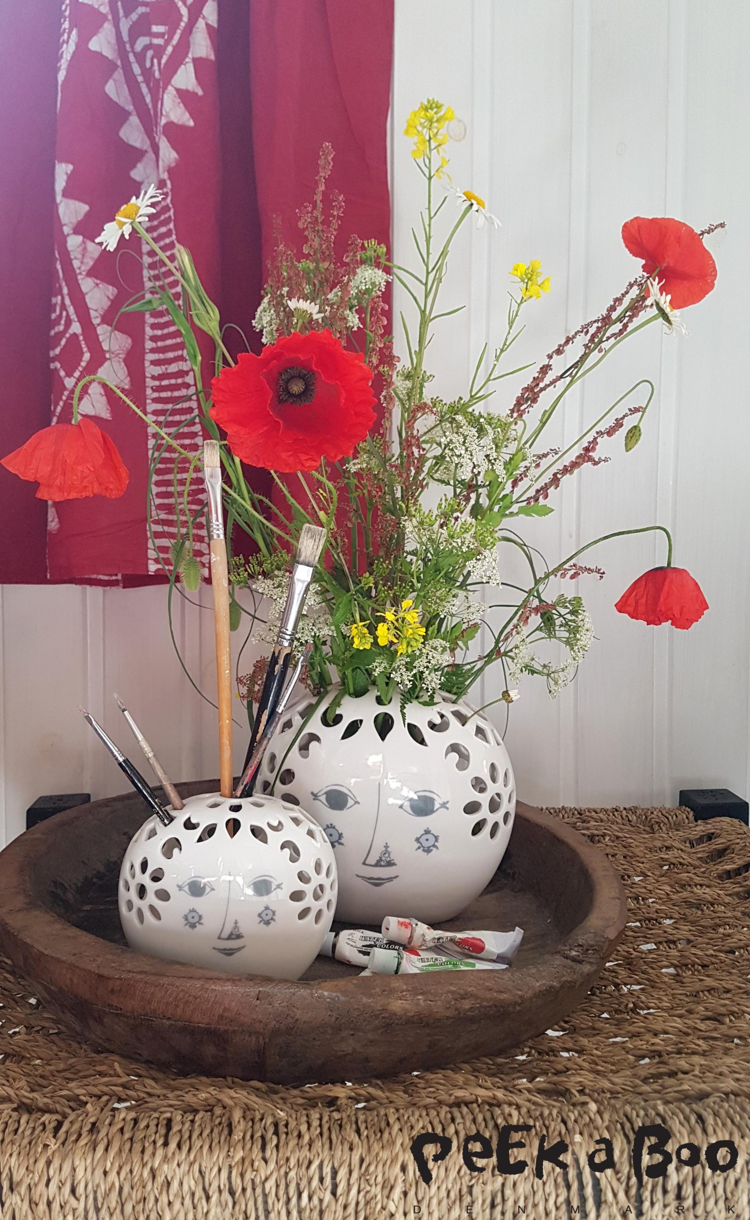 The vases can also be used for other things like your brushes for painting or makeup...that looks really cute.