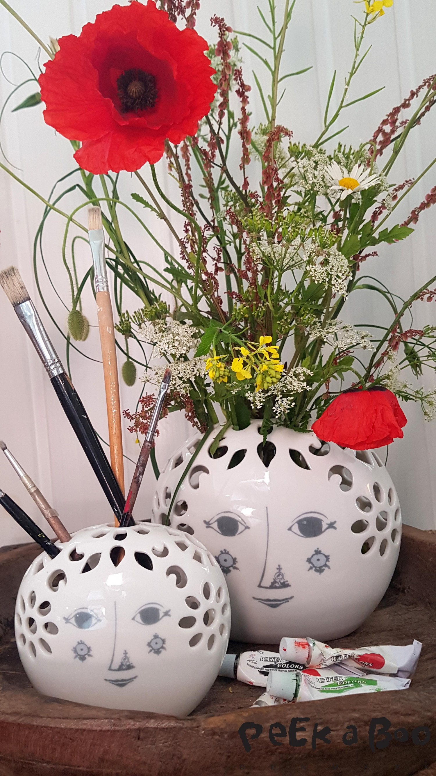 The new vases from the danish designer Bjørn Wiinblad. It is a fusion between the danish simplicity and the japanese Ikabana, a way to arrange flowers through holes in the top of the vase.