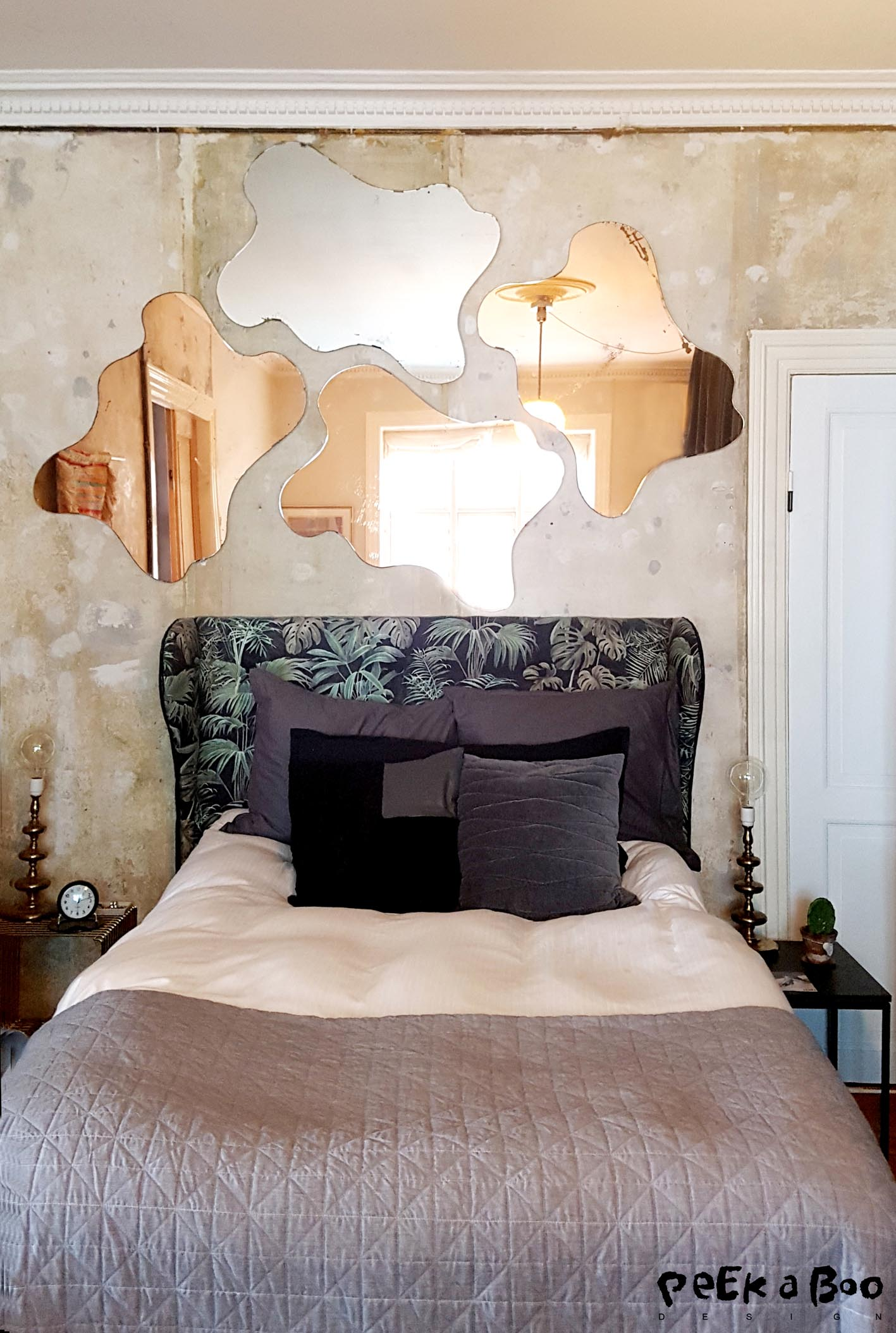 His and her side of the bed. The cloud shaped mirrors on the wall are secondhand finds. Three of them are in a cobber colour and one is plain. They are really unique and I have stored them for many years for one day to find the perfect spot for them....and that is here...do you agree?