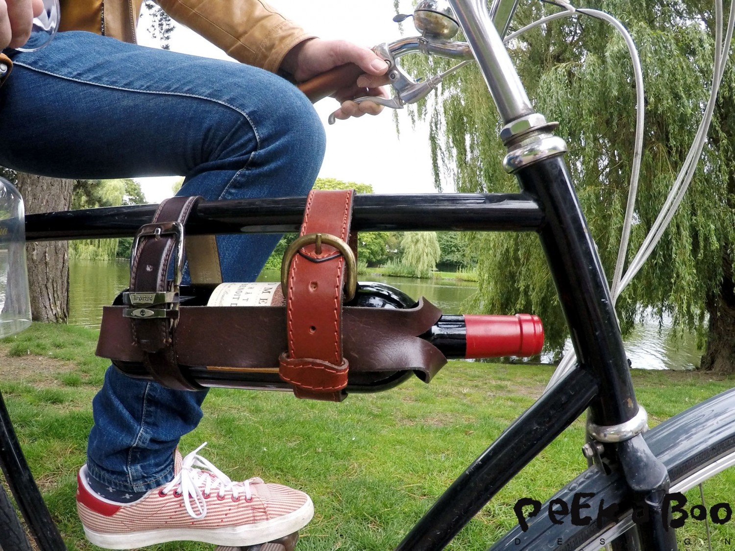 DIY upcycle your belt to be a wineholder for your bike.