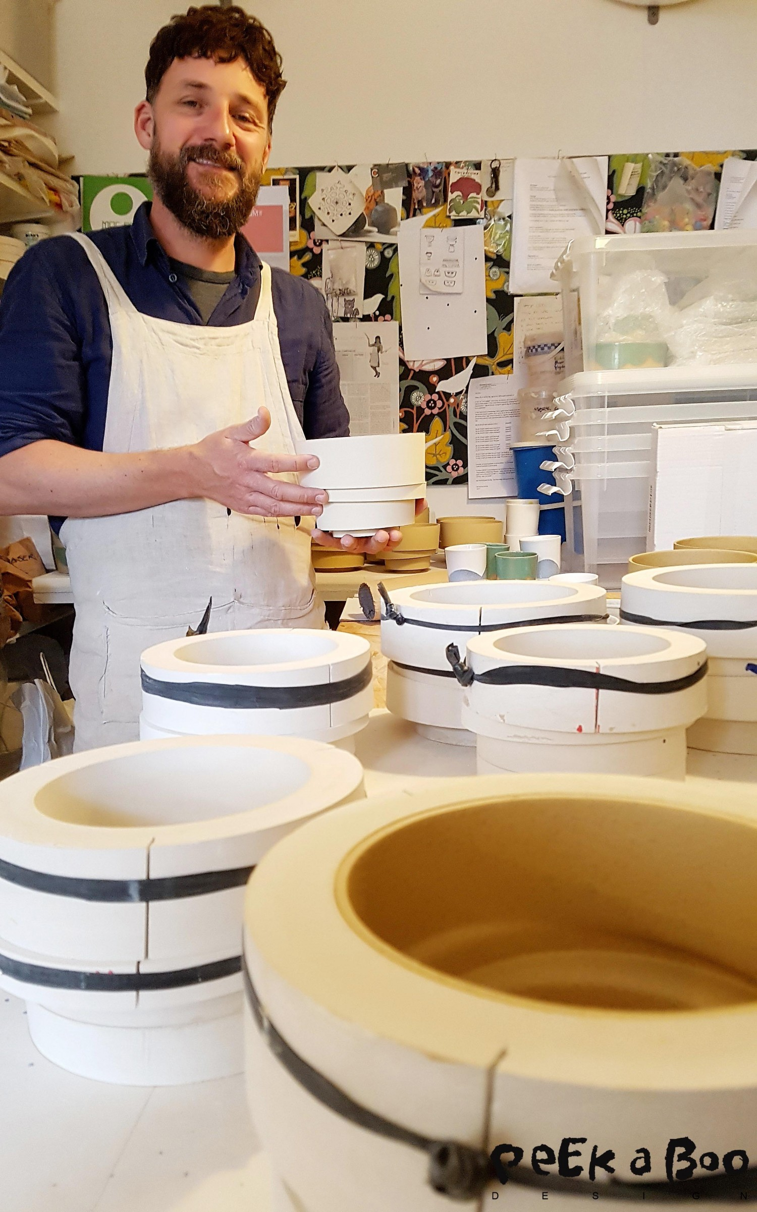 Lars Rank in his workspace, with tabel filled with moulds for more pots.