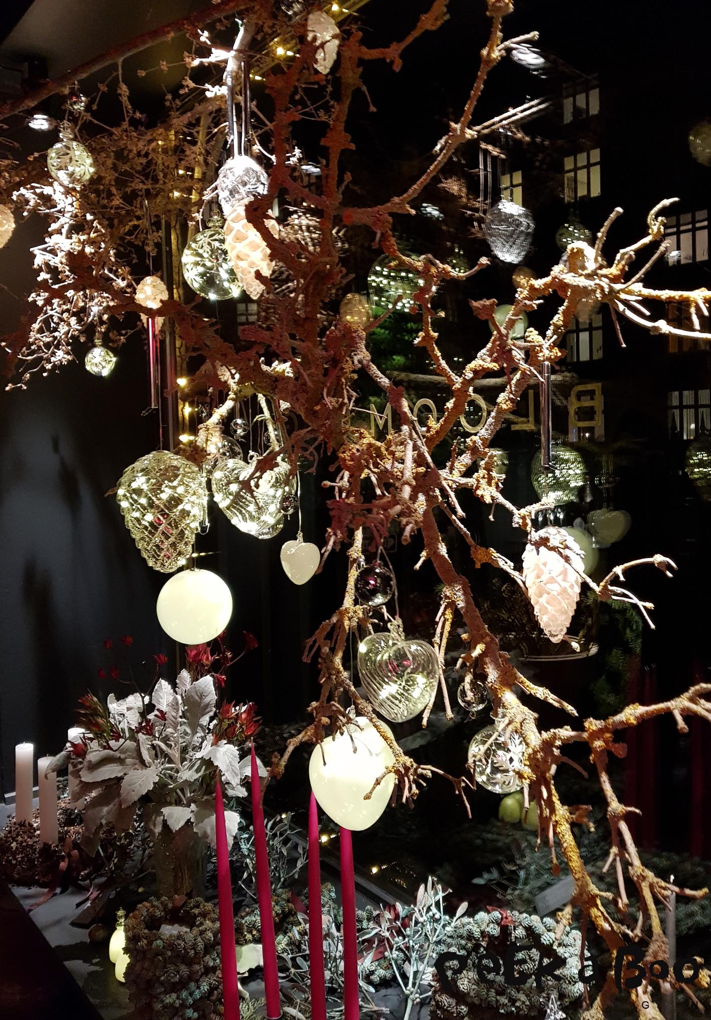 A huge selection of glass ornaments with light inside from Sirius shown in the window of Blooming.