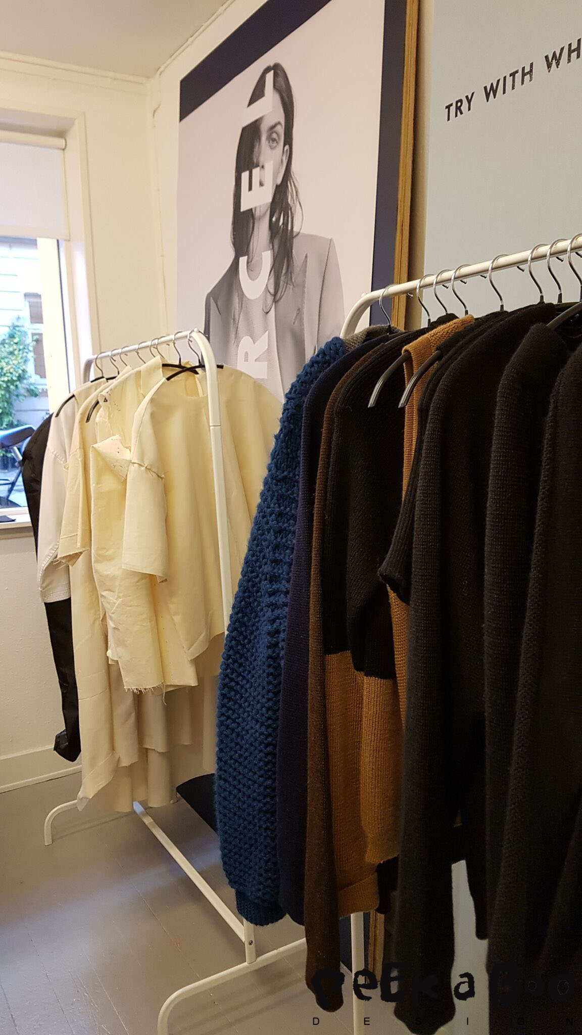 the collection and fittingsamples hanging in the studio of Carcel.