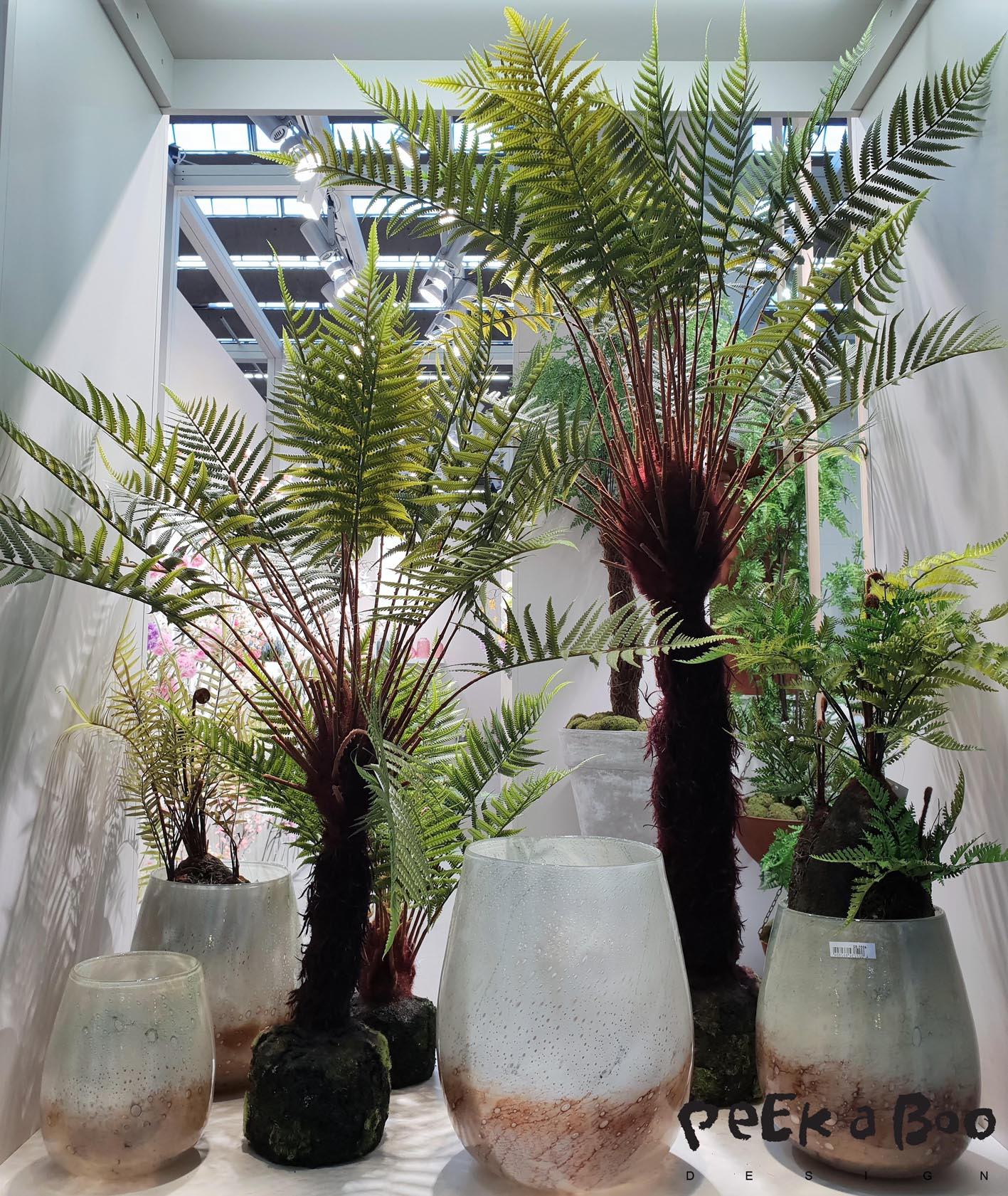 Artificial palms are looking very naturelike....You really have to look closely to notice that it is fake.