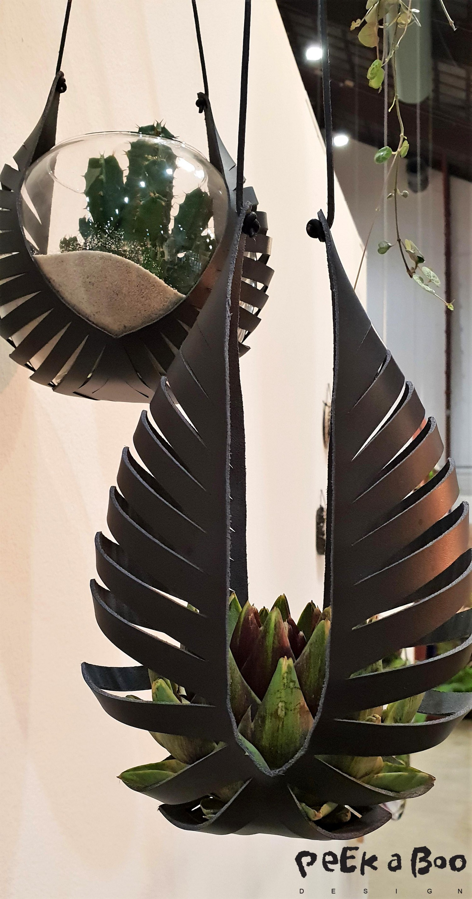 Leather hangers for your plants or bowls. From the danish brand Klejn & Strup.