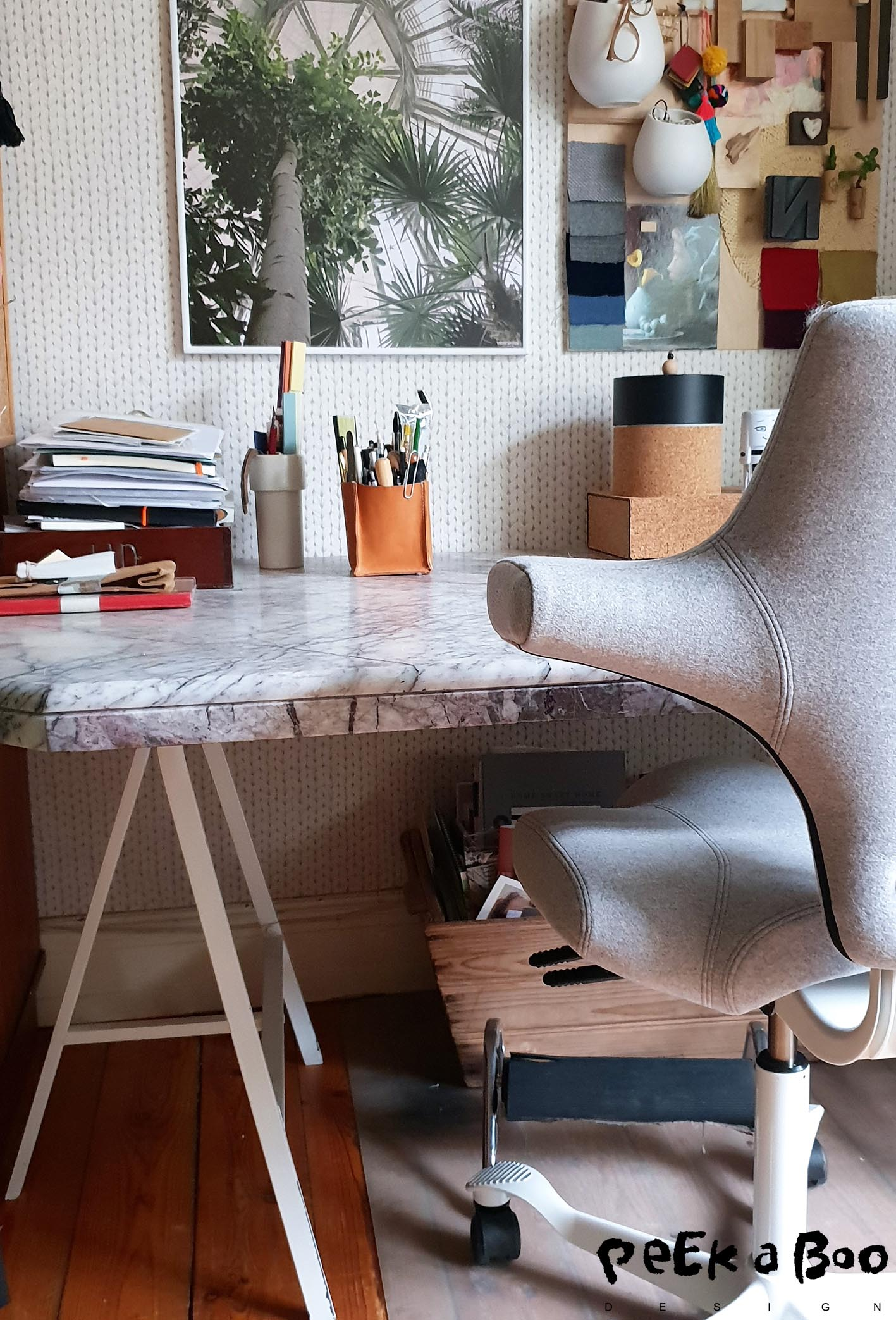 the upcycled marble table top on legs from Ikea gives the office an exclusive look.