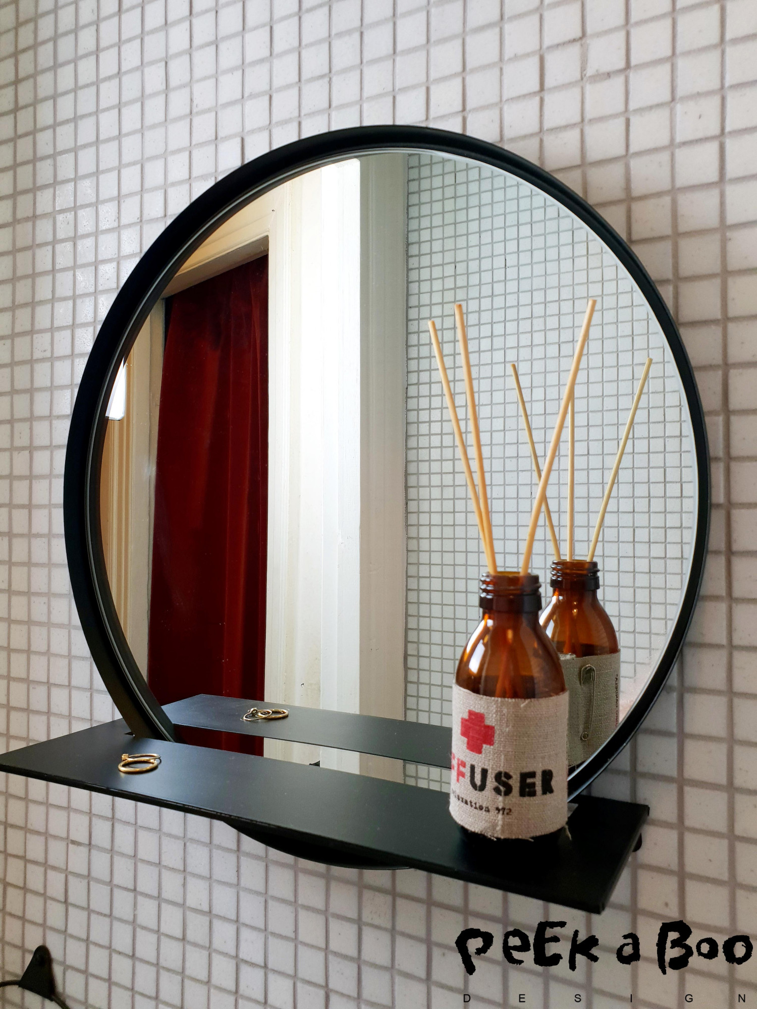 The new mirror with the small shelf