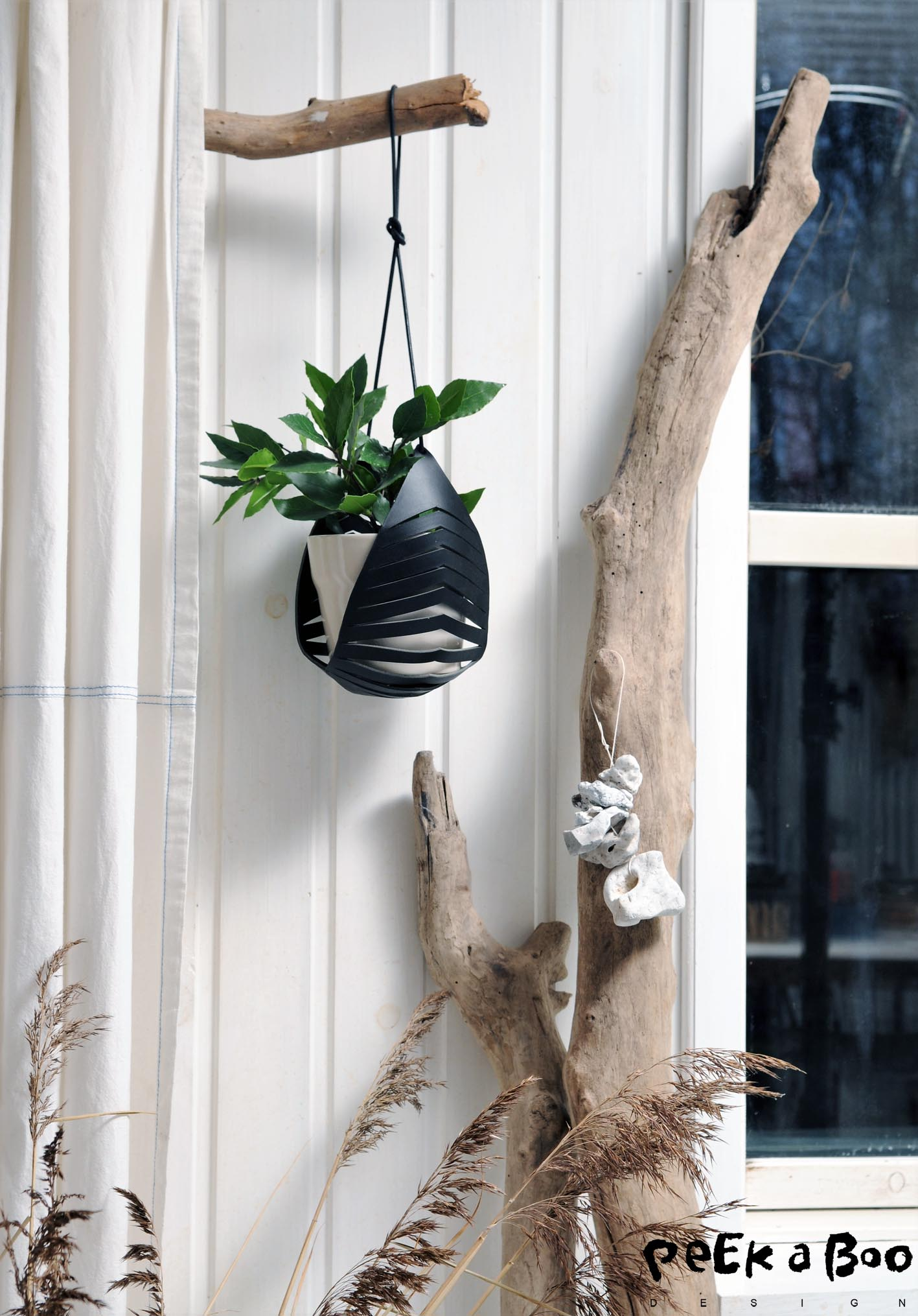 Hang this leather piece with a plant or maybe a basket for your make-up on your bathroom. This is very function and the simple design looks perfect in the modern homes.