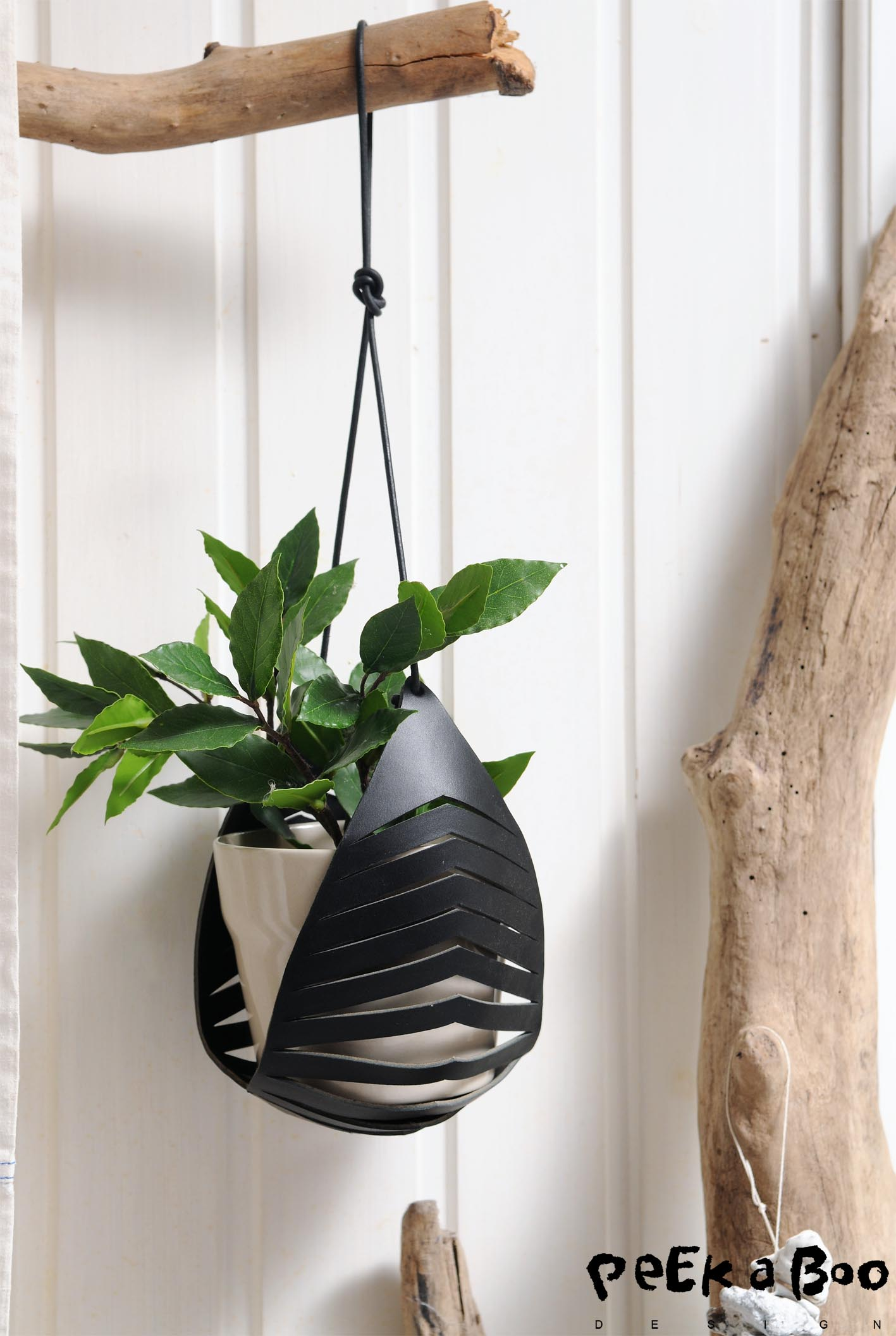 The leatherpiece for hangingpots are perfect for the urban green living trend.