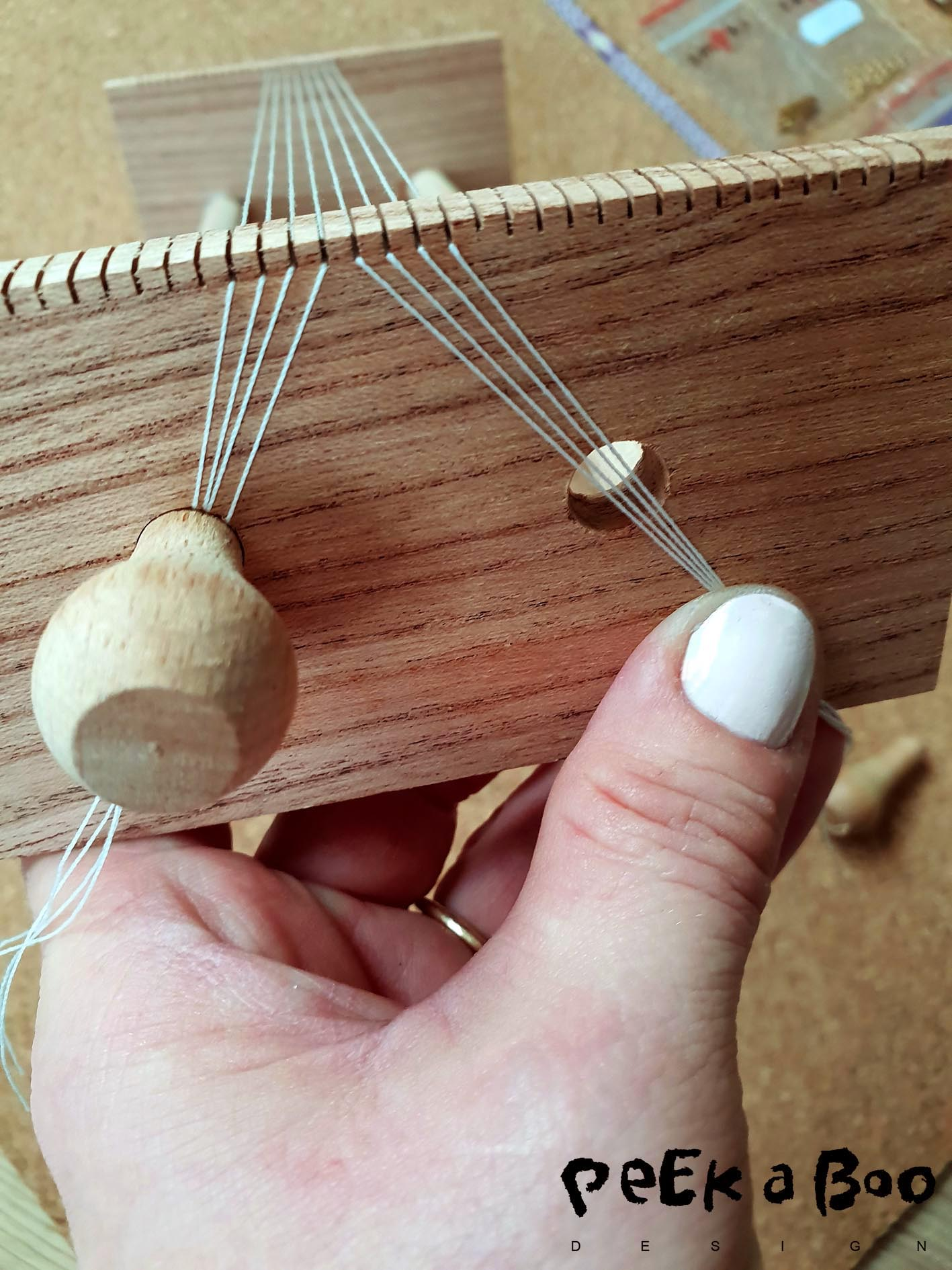 Then put the threads down into the grooves and tighten them into the holes by inserting the stoppers.