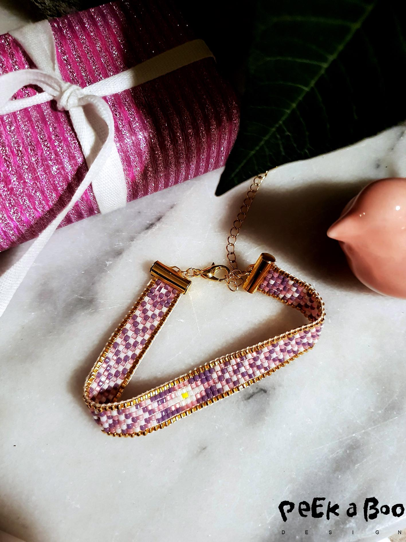 The pretty DIY bracelet made on a bead weave.