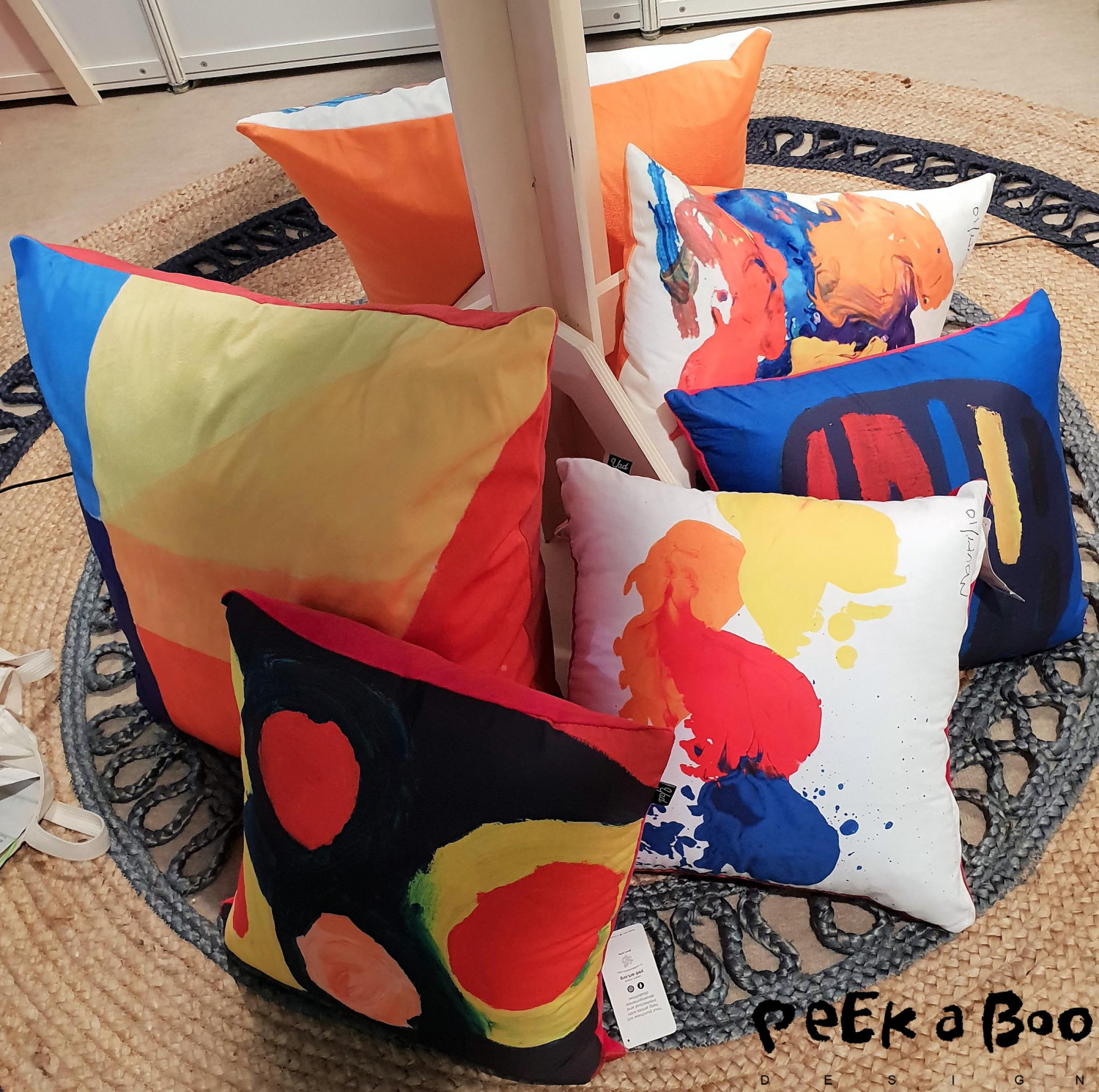 Colourful pillows made by JAD art. This is art made by people with different disabilities. Art painted with the heart. Go check out their website for much more interior that gives good sense supporting.