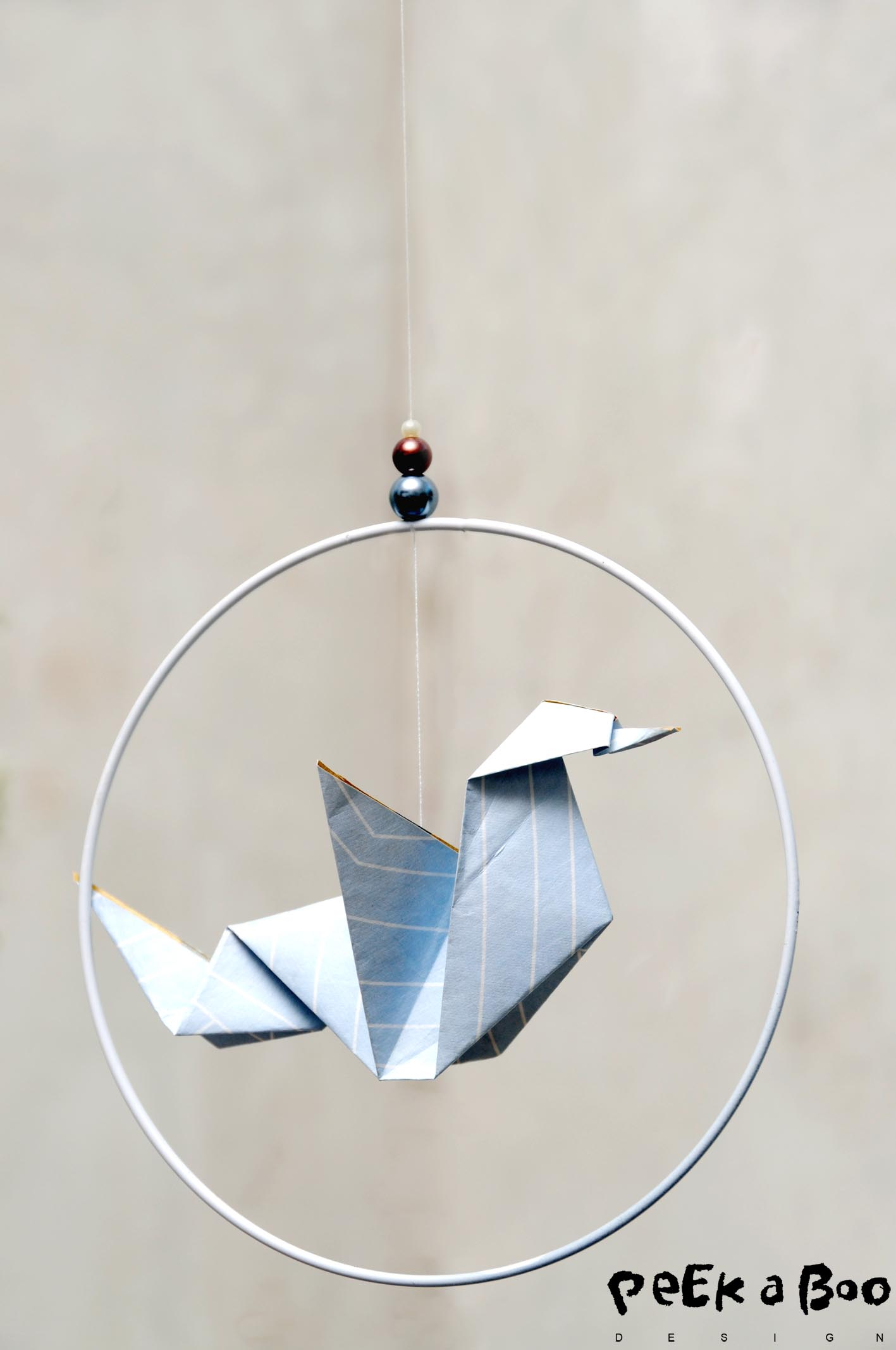 Origami bird in ring.