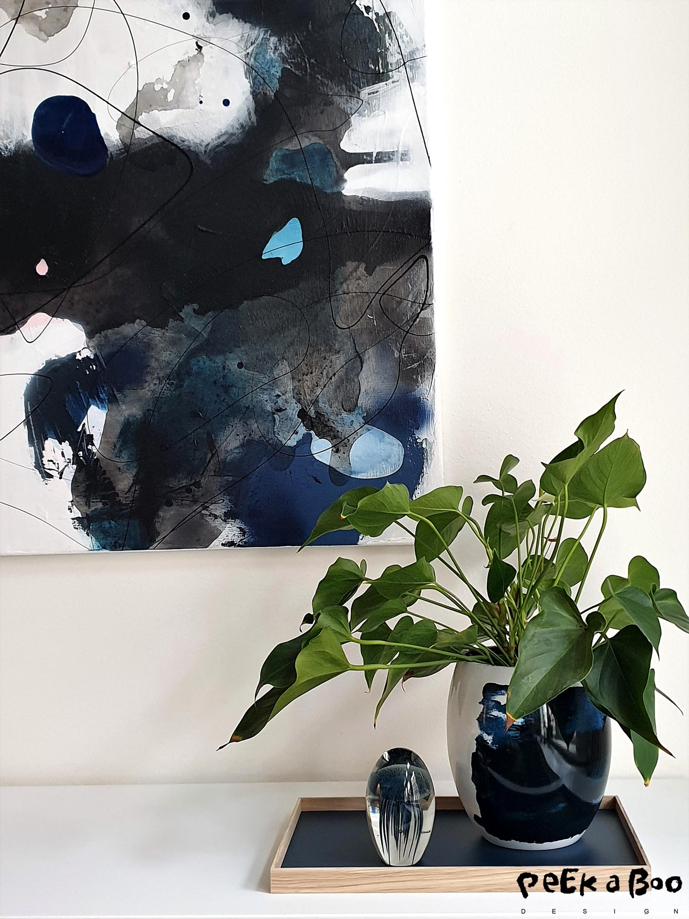 Artwork by Lerfeldt Bjerker and the vase is from Stelton designed by Bernadotte & Kylberg called Stockholm Aquatic.
