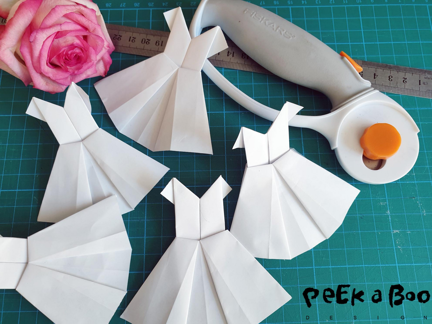 Folded origami dresses. See video for instructions.