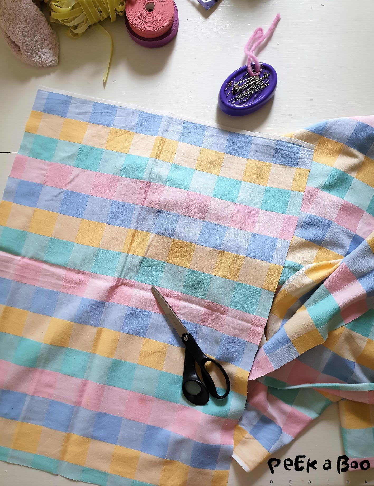 Start by cutting out squares that matches your prefered size of tea towels and try to get around the dirty spots on your tablecloth.