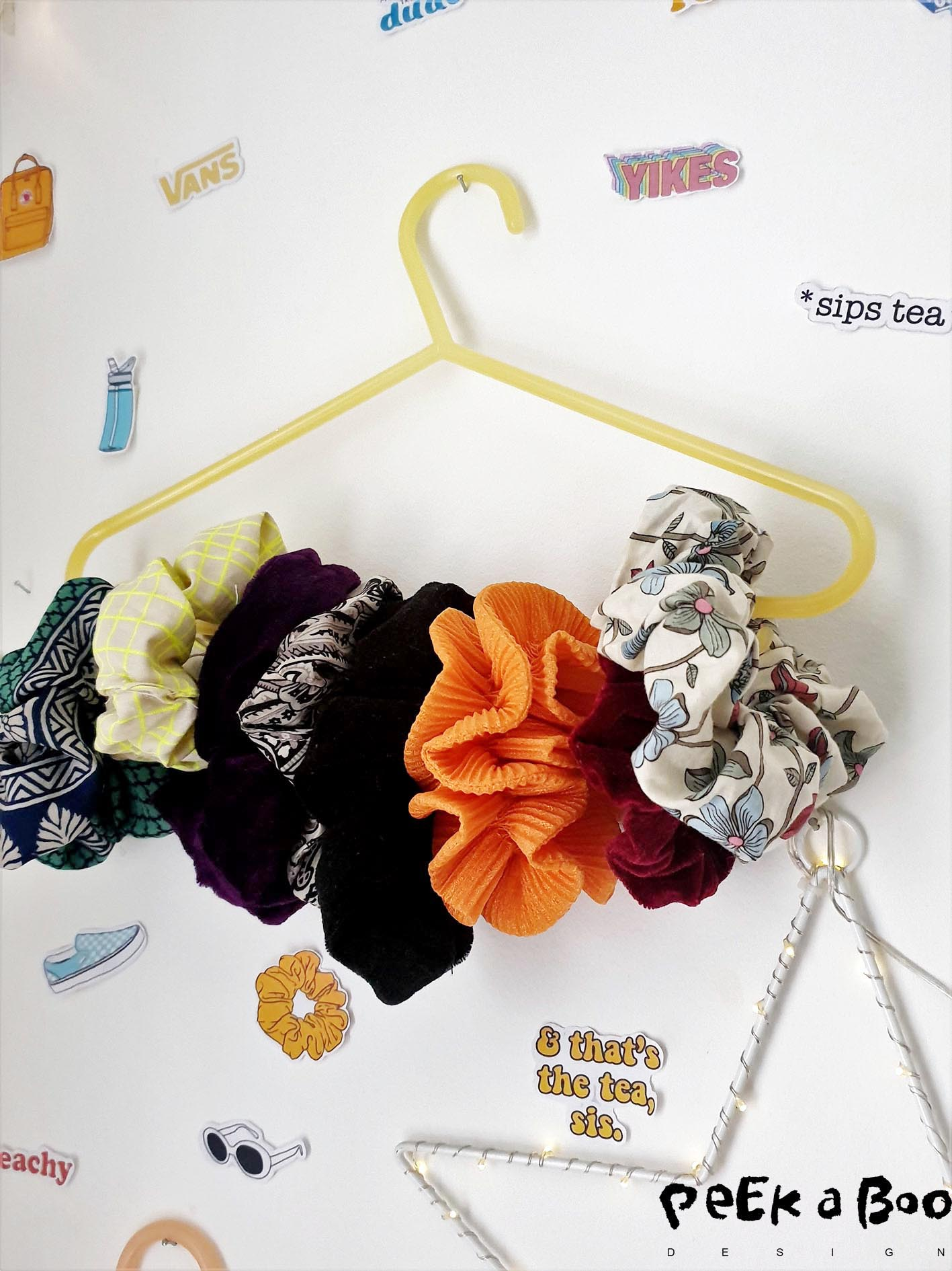 The look of the colourful scrunchies are very decorative on the wall.