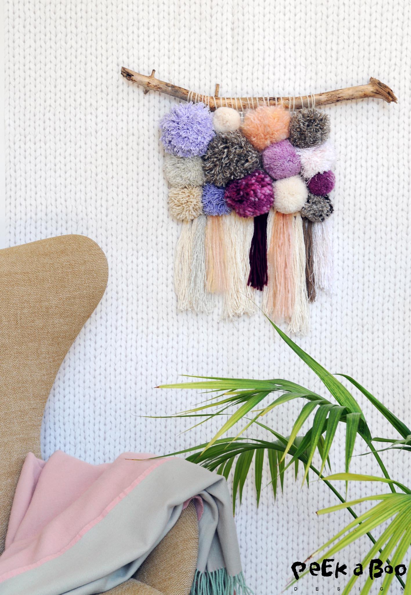 pompom wallhanger made of leftover yarns.