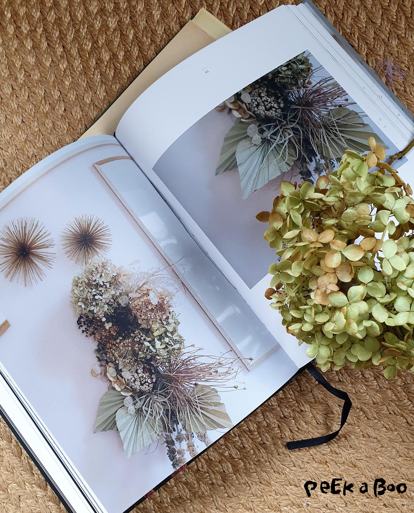 "One of the pages from the book ""Falmet skønhed"" where a walldecoration is made of dried hortensias."