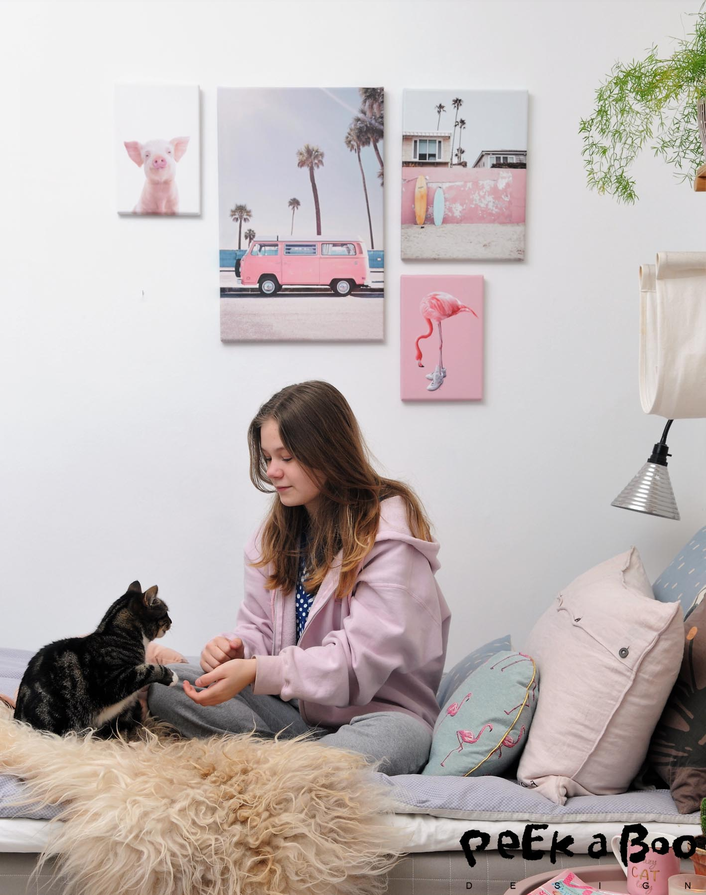 Flora and our cat Luna, enjoying the cosy corner with the pastel picturewall.