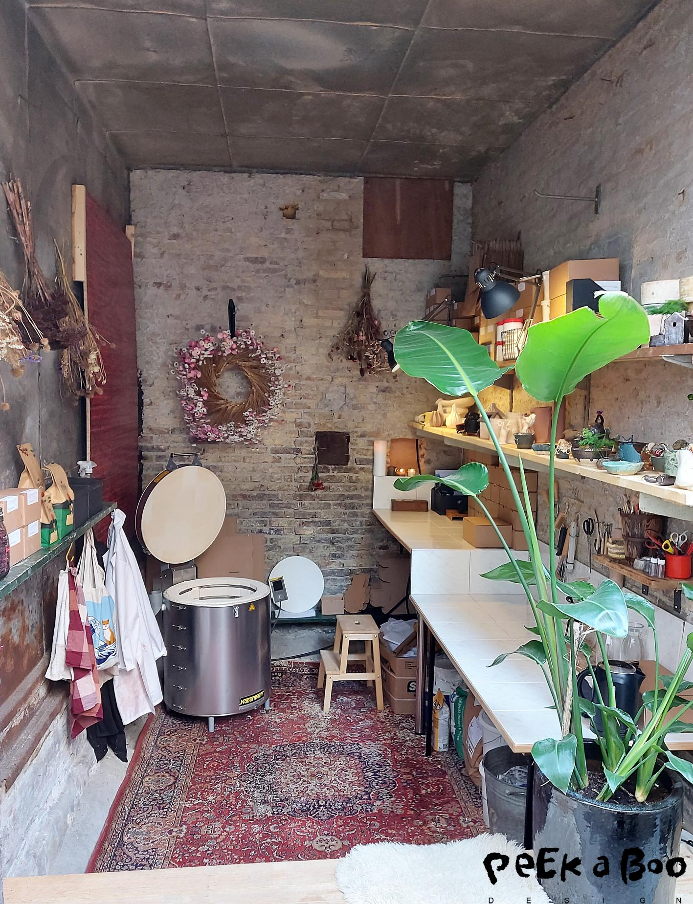 """The small workshop filled with ceramic and dried flowers from some of their freinds called """"dusk""""."""