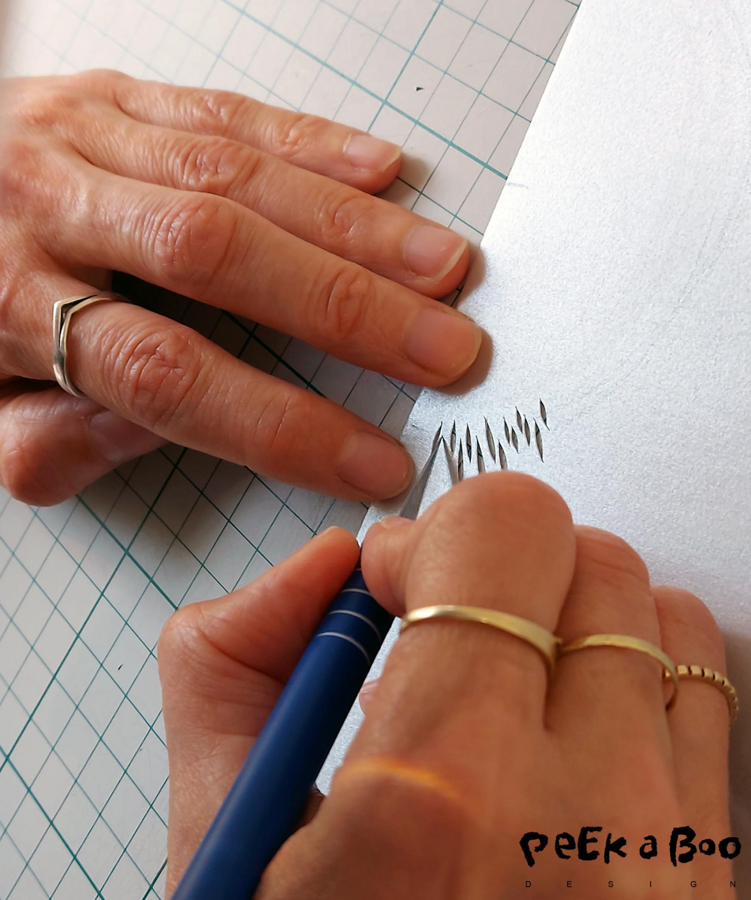 The delicate work where each hole in the paper is handcut by Vicki Zoé.