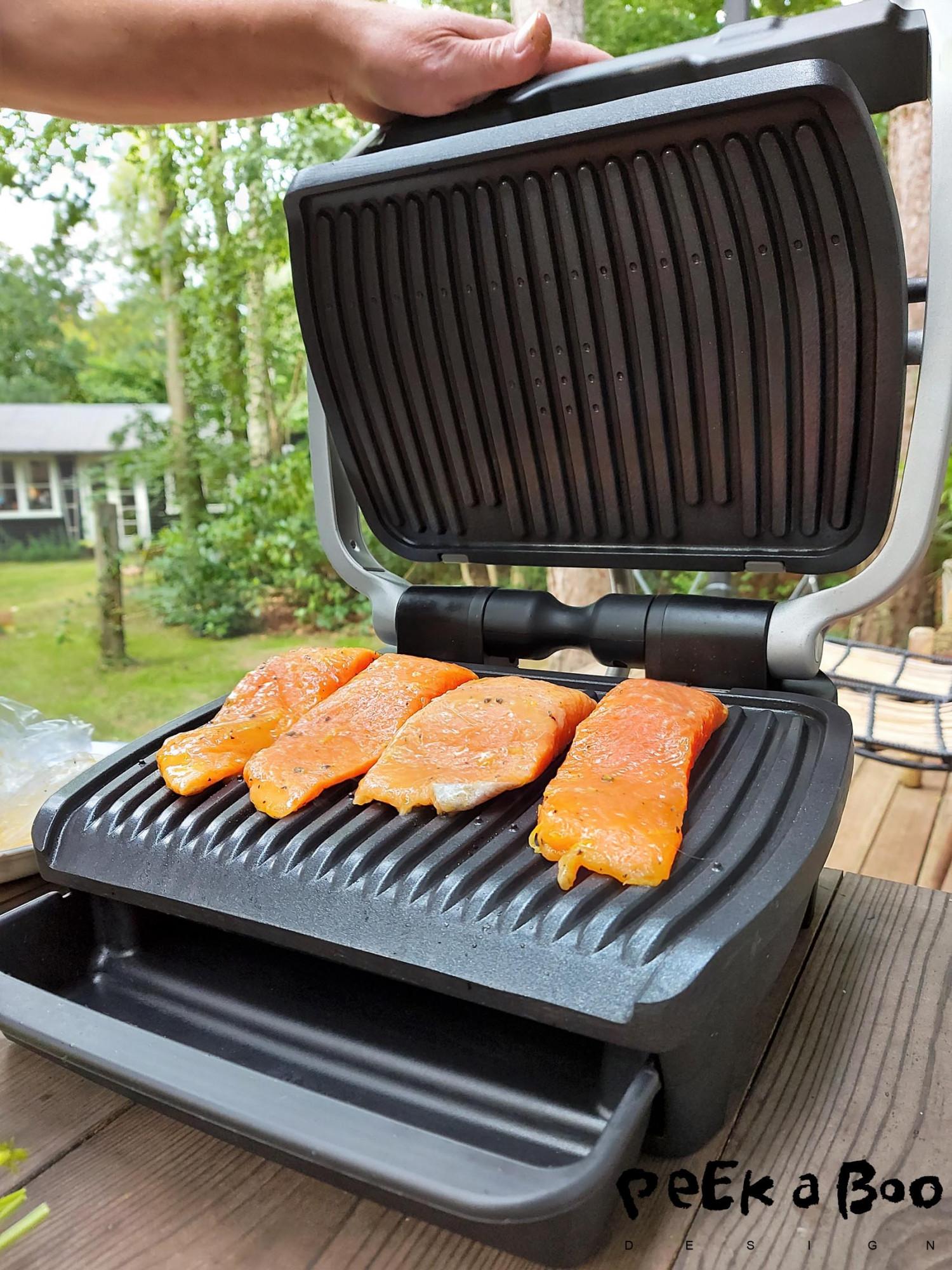 Preparing salmon on the OBH Opti Grill Elite.