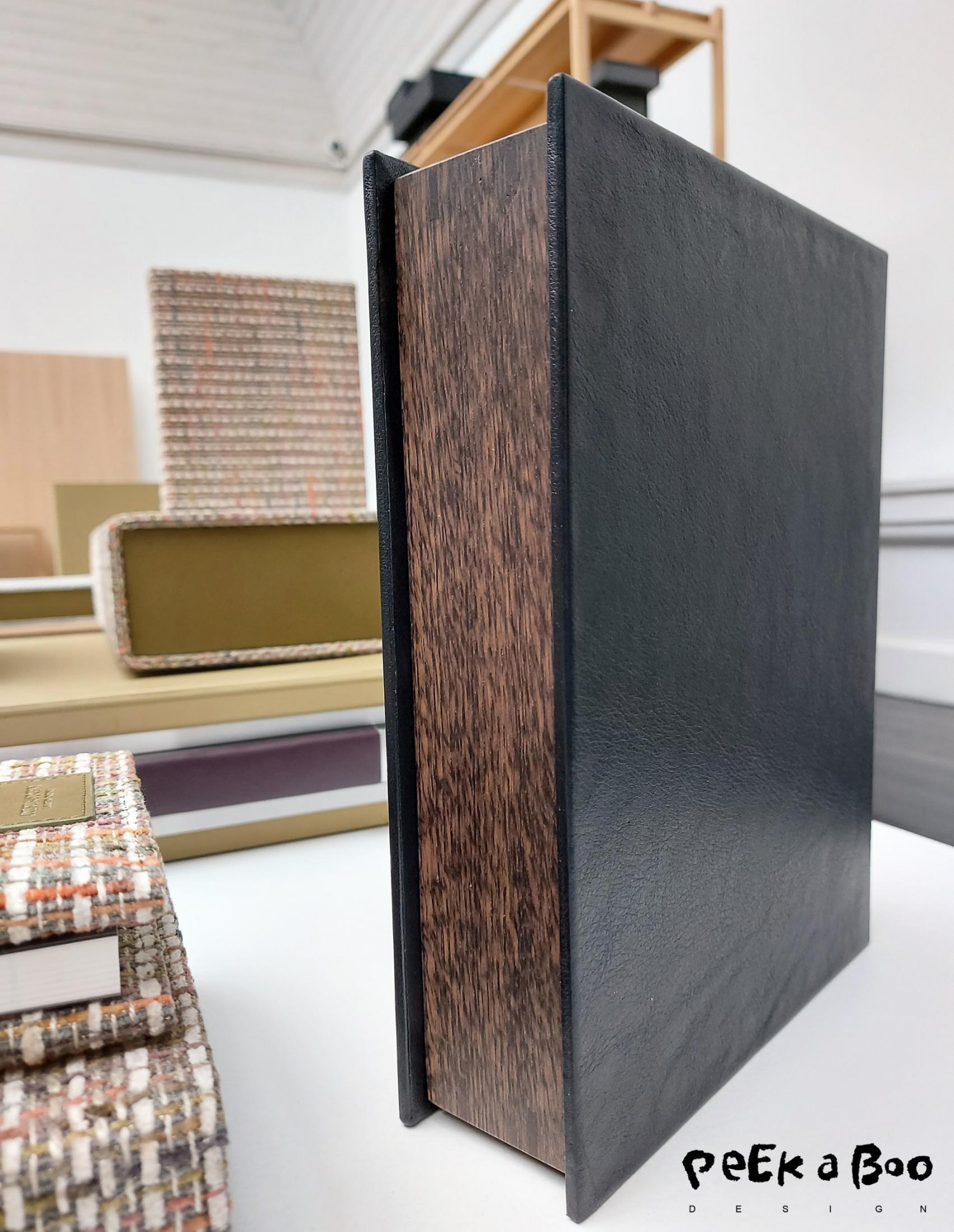 The new box from August Sandgren looks like a book when it is closed and put on a shelf.