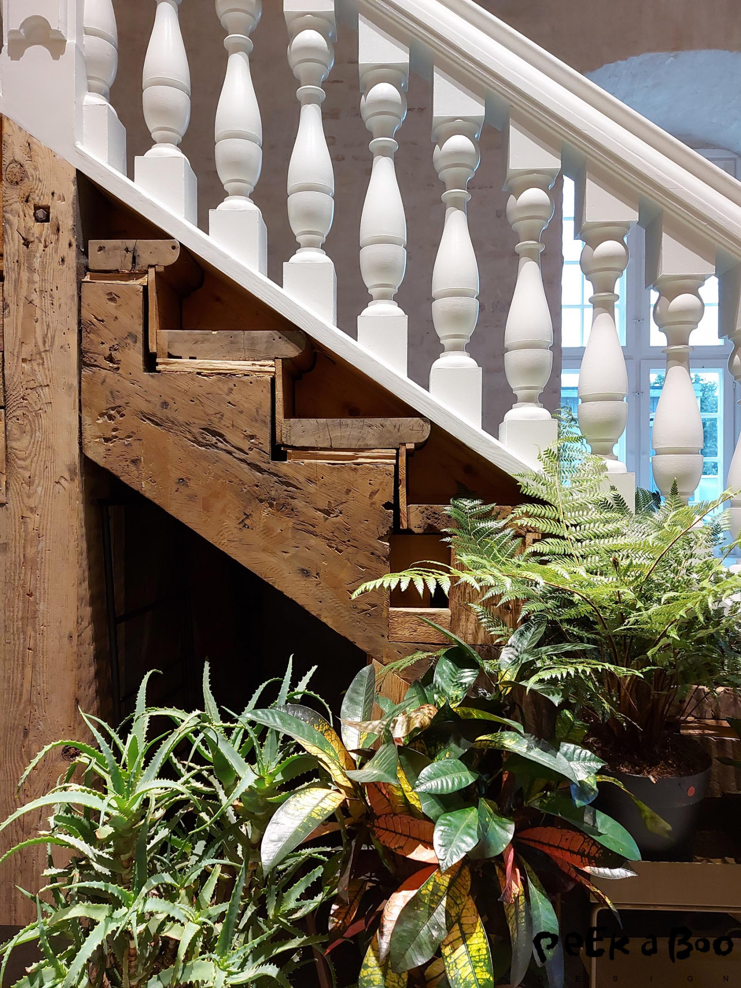 the staircase to the workspace of Ferm Living was a contrast of refined woodwork and rustic old wood.