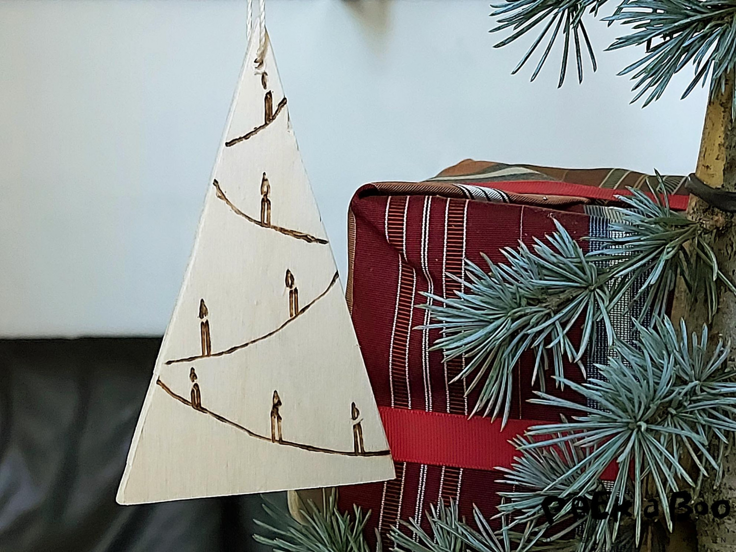 The easy peacy made christmas tree ornament made in plywood.
