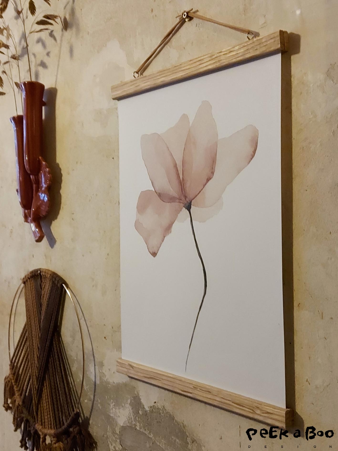 The pink painted flower in the oak wood hanger.